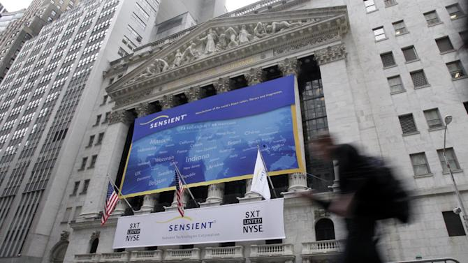 FILE - In this Feb. 2, 2012, file photo, a man passes the front of the New York Stock Exchange. All major U.S. indexes are shut down, Monday, Oct. 29, 2012, before Hurricane Sandy makes landfall. There had been plans to allow electronic trading to go forward on the New York Stock Exchange but with a storm surge expected to cover parts of lower Manhattan in water, officials decided late Sunday that it was too risky to ask any personnel to staff the exchanges. (AP Photo/Richard Drew, File)