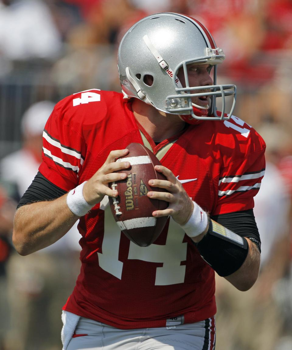 Ohio State quarterback Joe Bauserman drops back to pass against Akron during the first quarter of an NCAA college football game in Columbus, Ohio on Saturday, Sept. 3, 2011.  (AP Photo/Amy Sancetta)