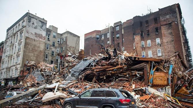 FILE - In this March 27, 2015, file photo, a pile of debris remains at the site of a building explosion in the East Village neighborhood of New York. While officials caution that they aren't certain of the cause of last week's blast in New York's East Village, it is highlighting a long-known problem with potentially deadly consequences: untrained schemers rigging up pipes to save money by siphoning natural gas. (AP Photo/The New York Times, Nancy Borowick, Pool, File)