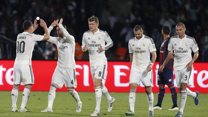 Real Madrid's Ramos celebrates his first goal with his team mates during their Club World Cup final match against San Lorenzo at the Marrakech stadium