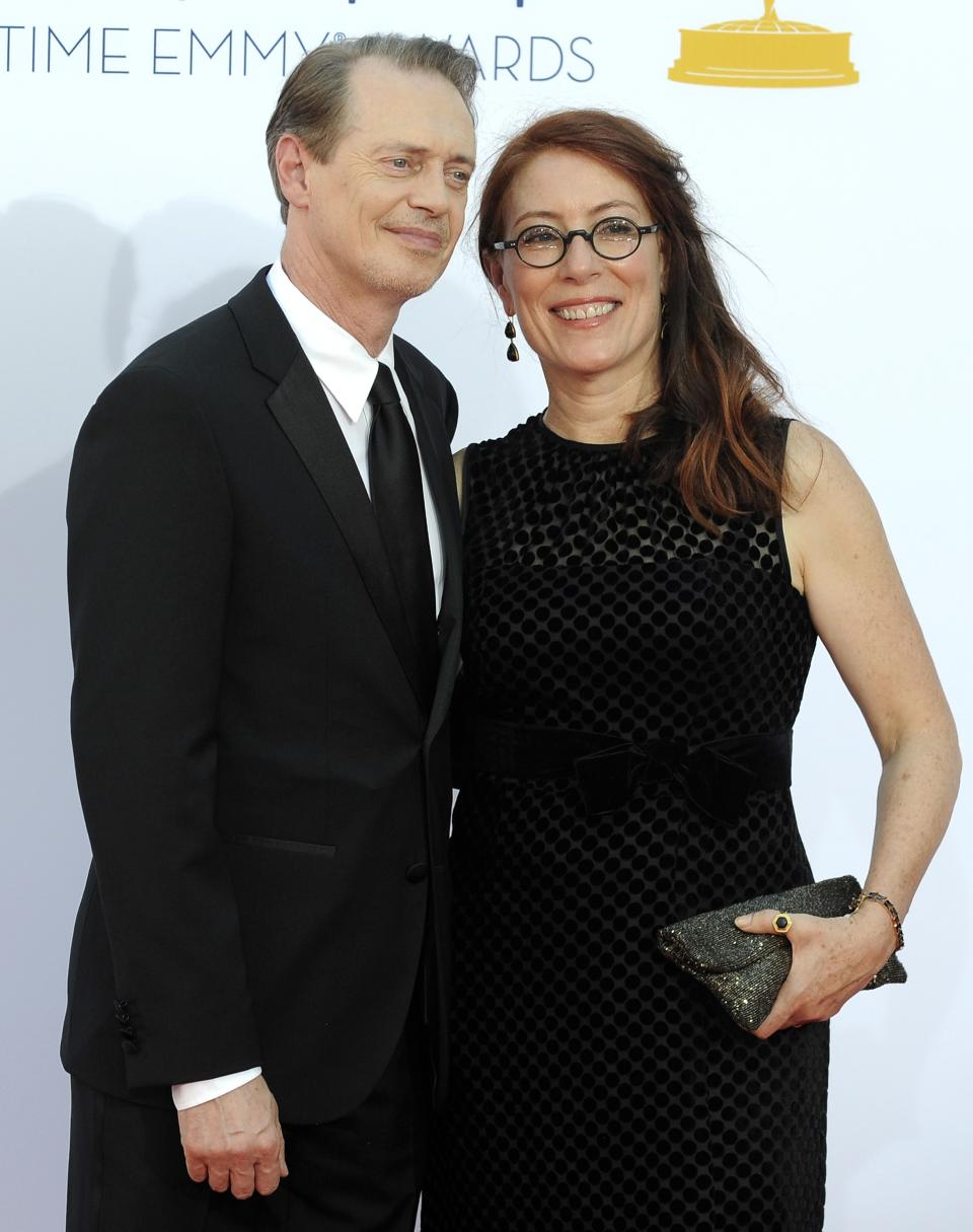 Actor Steve Buscemi, left, and his wife Jo Andres arrive at the 64th Primetime Emmy Awards at the Nokia Theatre on Sunday, Sept. 23, 2012, in Los Angeles.  (Photo by Jordan Strauss/Invision/AP)