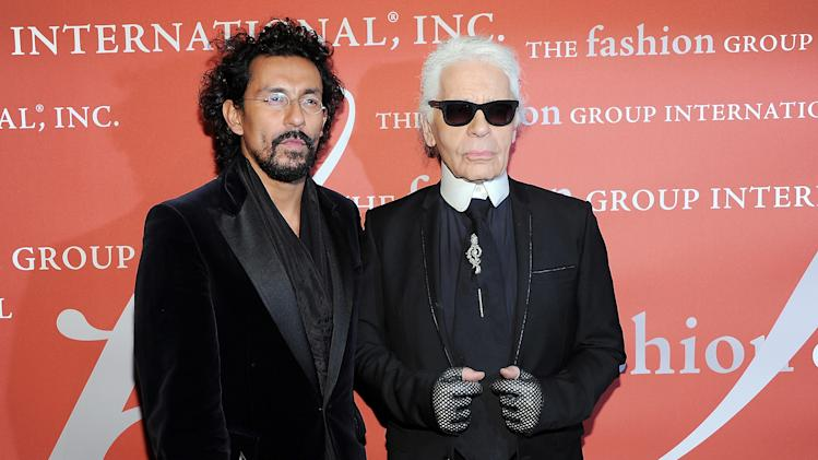 """Star"" award honoree, designer Haider Ackerman, left, poses with presenter Karl Lagerfeld at the 29th Annual ""Night Of Stars"" presented by The Fashion Group International at Cipriani Wall Street on Thursday Oct. 25, 2012 in New York. (Photo by Evan Agostini/Invision/AP)"