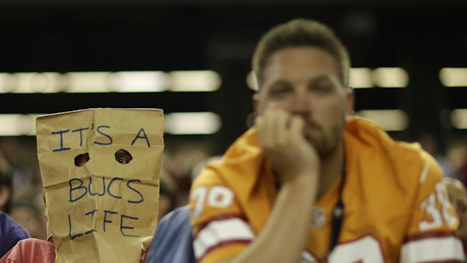 A Tampa Bay Buccaneers fan watches play against the Atlanta Falcons during the second half of an NFL football game, Thursday, Sept. 18, 2014, in Atlanta