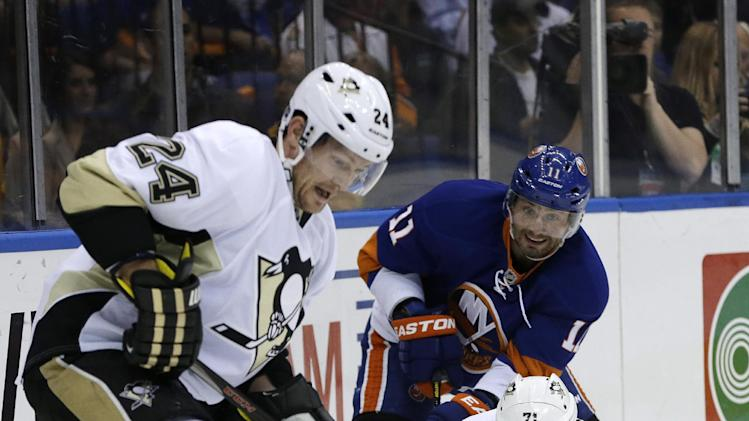 New York Islanders defenseman Lubomir Visnovsky (11), of Slovakia, defends Pittsburgh Penguins center Evgeni Malkin (71,) of Russia, as Pittsburgh Penguins left wing Matt Cooke (24) gains control of the puck behind the Islanders net in the first period of Game 6 of a first-round NHL Stanley Cup playoff hockey series in Uniondale, N.Y., Saturday, May 11, 2013. (AP Photo/Kathy Willens)