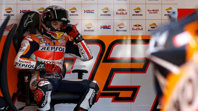 Honda MotoGP rider Marquez of Spain wipes his eyes in his pit garage during a free practice session at the Twin Ring Motegi circuit ahead of Sunday's Japanese Grand Prix in Motegi