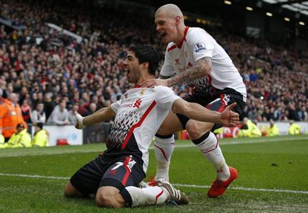 Liverpool's Luis Suarez (L) celebrates with Martin Skrtel after scoring his side's third goal during their English Premier League soccer match against Manchester United at Old Trafford in Manc