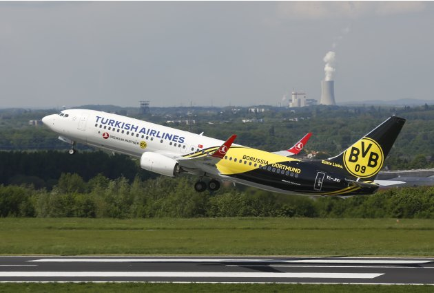 Plane carrying Borussia Dortmund players departs from Dortmund's airport to London