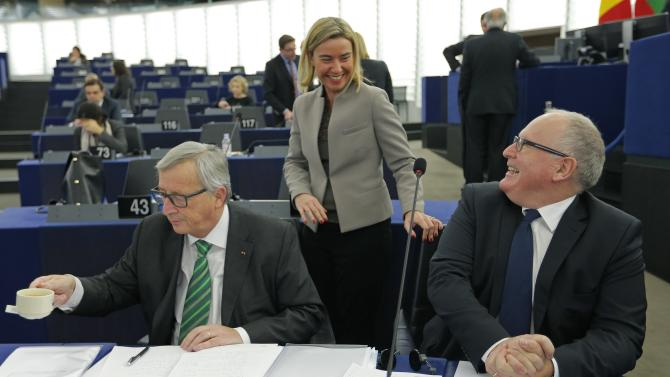 European Union Foreign Policy Chief Mogherini talks with European Commission President Juncker and Vice-President of the European Commission Timmermans ahead of a debate on Paris attacks at the European Parliament in Strasbourg