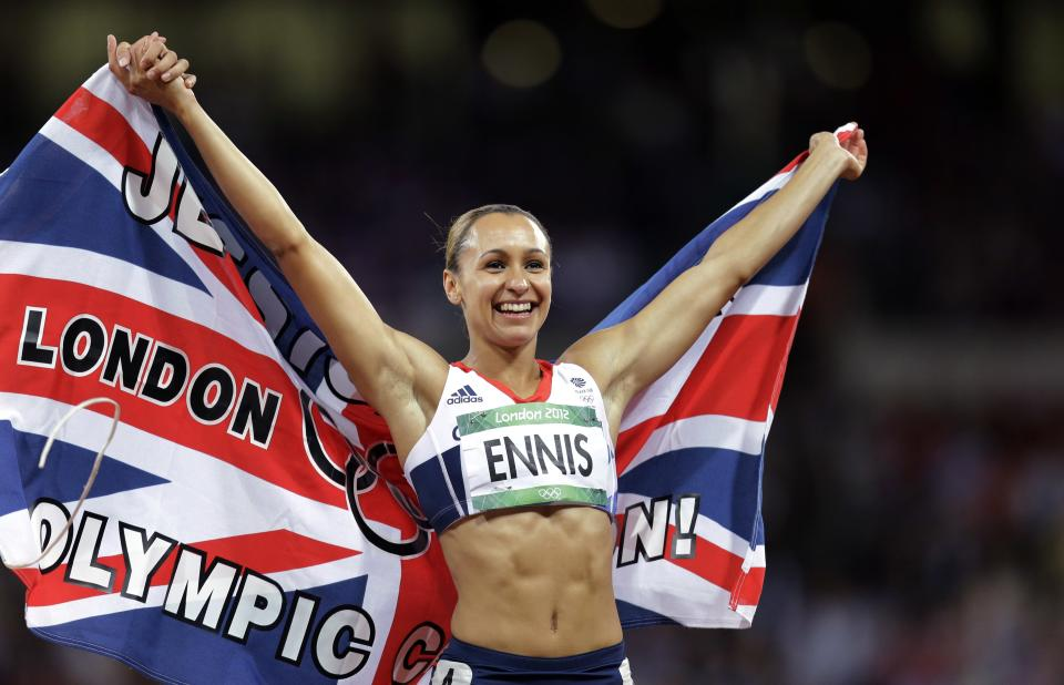 Britain's Jessica Ennis celebrates winning the gold in the women's heptathlon during athletics competition in the Olympic Stadium at the 2012 Summer Olympics, Saturday, Aug. 4, 2012, in London. (AP Photo/David J. Phillip )