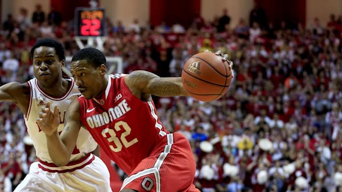 Ohio State's Lenzelle Smith Jr., (32) drives to the basket against Indiana's Yogi Ferrell during the first half of an NCAA college basketball game, Tuesday, March 5, 2013, in Bloomington, Ind. (AP Photo/Darron Cummings)