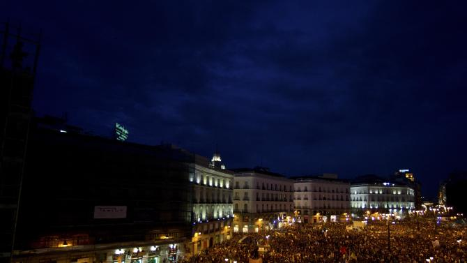 The view from a balcony as protesters pack the Puerta del Sol plaza in central Madrid Saturday May 12, 2012. The protesters returned to Sol to mark the anniversary of the protest movement that inspired groups in other countries. The protests began May 15 last year and drew hundreds and thousands of people calling themselves the indignant movement. The demonstrations spread across Spain and Europe as anti-austerity sentiment grew. (AP Photo/Paul White)
