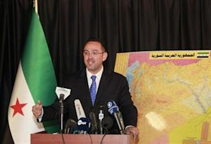 Syrian National Coalition spokesman Khaled Saleh speaks during a news conference in Istanbul