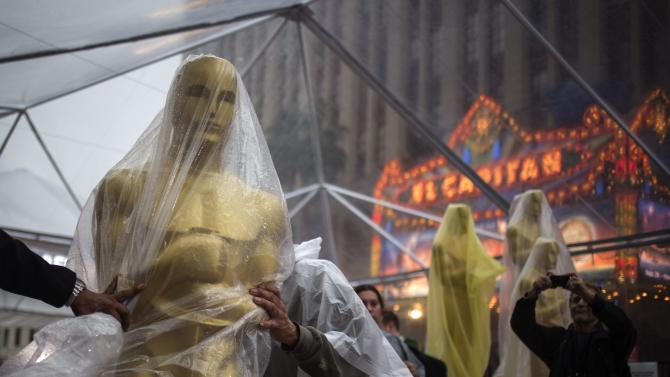 A covered Oscars statue is moved along the red carpet ahead of the 86th Academy Awards in Hollywood, California