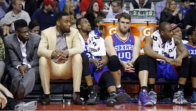 From left, Philadelphia 76ers center Nerlens Noel, forward Arnett Moultrie, forward Thaddeus Young, center Spencer Hawes (00) and guard James Anderson sit on the bench during the fourth quarter of an