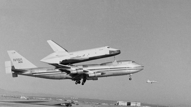 FILE - In this Feb. 18, 1977 file photo, America's Space Shuttle Enterprise, rides atop a giant 747 on its first test flight at Edwards Air Force Base, Calif. Enterprise has been separated from the NASA 747 Shuttle Carrier at John F. Kennedy International Airport, just weeks after flying over New York City. Next month it will be taken by barge to the aircraft carrier USS Intrepid, the floating air-and-space museum that will be the shuttle's permanent home. The shuttle is scheduled to open to the public in mid-July. (AP Photo, File)
