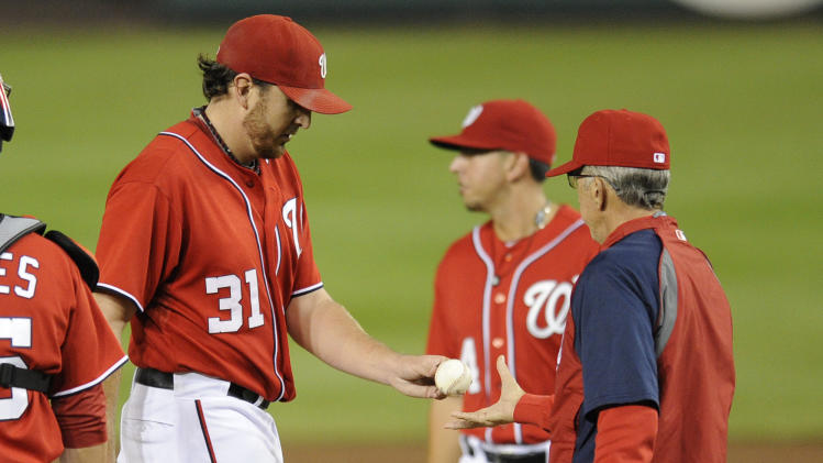 Washington Nationals starting pitcher John Lannan (31) is pulled from the game by manager Davey Johnson, right, during the third inning of a baseball game against the Houston Astros, Saturday, Sept. 10, 2011, in Washington. (AP Photo/Nick Wass)