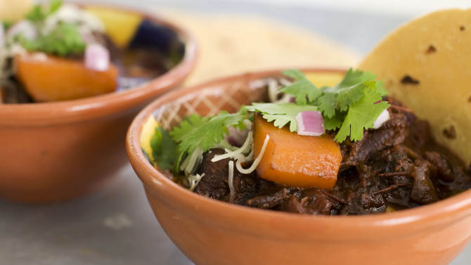 In this image taken on January 7, 2013, Mexican beef brisket and winter squash chili is shown served in bowls in Concord, N.H. (AP Photo/Matthew Mead)