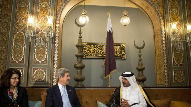 U.S. Ambassador to Qatar in Susan Ziadeh, left, sits with U.S. Secretary of State John Kerry and Qatar Crown Prince, Sheik Tamim bin Hamad Al Thani, during their meeting at the Prince's Sea Palace residence in Doha, Qatar on Tuesday, March 5, 2013. Qatar is the ninth and final country on Kerry's first official trip overseas as secretary. (AP Photo/Jacquelyn Martin, Pool)