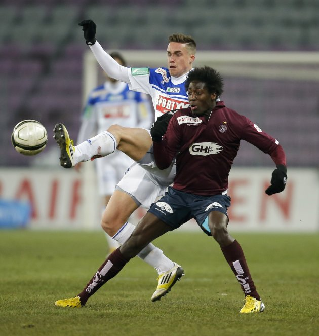 FC Lausanne-Sport's Facchinetti fights for the ball with FC Servette's Kossoko during their Swiss Super League soccer match in Geneva
