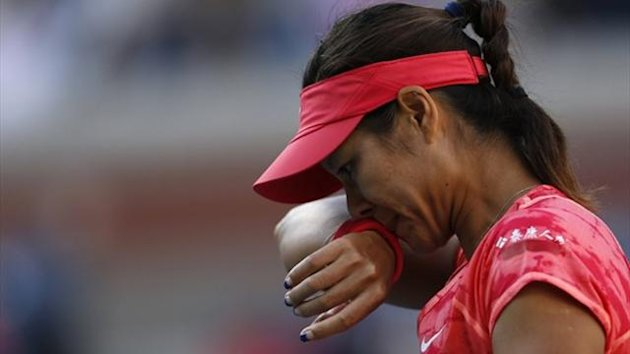 Li Na of China wipes her face during her match against Serena Williams of the US Open (Reuters)