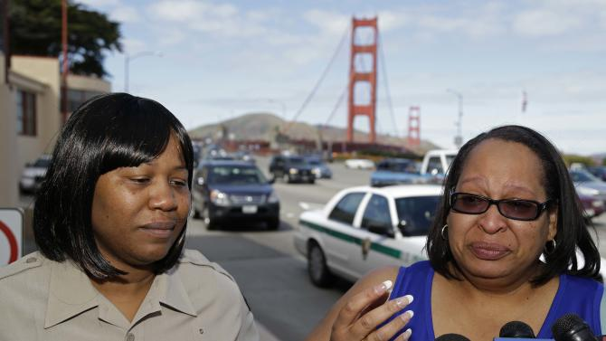 Toll takers Dawnette Reed, left, and Jacquie Dean, right, talk with reporters about their last day on the job at the Golden Gate Bridge Tuesday, March 26, 2013 in San Francisco. The historic bridge will take a high-tech leap forward when it becomes the first California span to replace all human toll takers with an electronic system that ends the need for motorists to stop and pay cash. Toll takers will collect money for the last time early Wednesday before the toll booths are closed for good. (AP Photo/Eric Risberg)