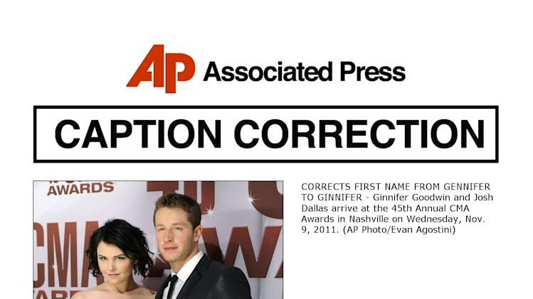 CORRECTS FIRST NAME FROM GENNIFER TO GINNIFER - Ginnifer Goodwin and Josh Dallas arrive at the 45th Annual CMA Awards in Nashville on Wednesday, Nov. 9, 2011. (AP Photo/Evan Agostini)