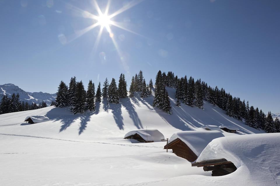 Huts are covered with snow on  Maiensaess Lafet mountain above Castiel, Switzerland Monday Feb. 6, 2012.  Europe was hit by a cold spell with temperatures plummeting far below the freezing point.  (AP Photo/Keystone/Arno Balzarini)
