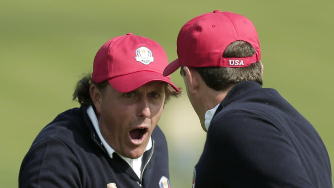 USA's Phil Mickelson, left, and Keegan Bradley celebrate after winning their foursomes match on the 15th hole at the Ryder Cup PGA golf tournament Friday, Sept. 28, 2012, at the Medinah Country Club in Medinah, Ill. (AP Photo/Charlie Riedel)
