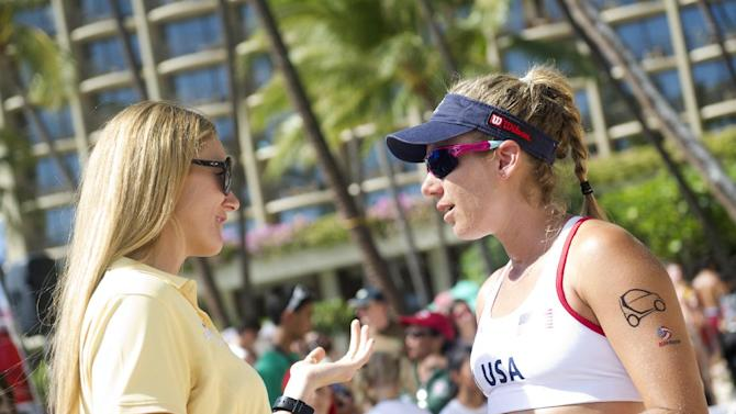 IMAGE DISTRIBUTED FOR HILTON HHONORS - In this image released on Monday, Oct. 29, 2012, Three-time Olympic Gold medalist Kerri Walsh Jennings, left, and Team USA athlete April Ross speak in advance of an exhibition match between Team USA and Team China during the Hilton HHonors Beach Volleyball Challenge, hosted by Hilton HHonors and USA Volleyball, at the Hilton Hawaiian Village Waikiki Beach Resort on Saturday, Oct. 20, 2012. The women's match will broadcast on Saturday, Dec. 1, 2012 on NBC Sports Network and the men's match will broadcast Saturday, Nov. 3, 2012 on NBC Universal. (Lucy Pemoni/AP Images for Hilton HHonors)