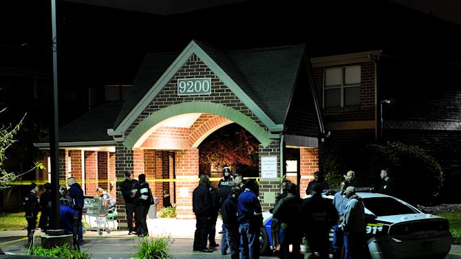 Police swarm the scene after two women were gunned down around 5:45 p.m. Sunday, Oct. 20, 2013 at the Pablo Davis Elder Living Center in Detroit, Mich. A 65-year-old man who lives at the senior center was in custody Sunday after police said he shot and killed two women that he blamed for a breakup with his girlfriend. (AP Photo/The Detroit News Ricardo Thomas)DETROIT FREE PRESS OUT; HUFFINGTON POST OUT