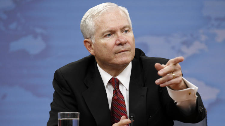 "FILE - In this June, 2011 file photo, Secretary of Defense Robert Gates points to a question during a media availability at the Pentagon in Washington. Gates says he's worried there's a perception of the United States ""disengaging"" from global affairs. (AP Photo/Alex Brandon)"