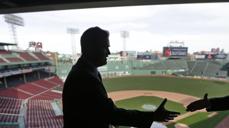 Boston Red Sox manager John Farrell reaches out to shake hands at Fenway Park in Boston, Tuesday, Oct. 23, 2012.  Farrell becomes the 46th manager in the club's 112-year history. (AP Photo/Charles Krupa)
