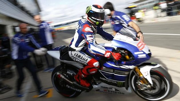 Yamaha MotoGp rider Jorge Lorenzo of Spain exits his garage during the first free practice session ahead of the British Grand Prix at the Silverstone