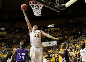 Wyoming tops TCU 71-59, reaches 20 victories