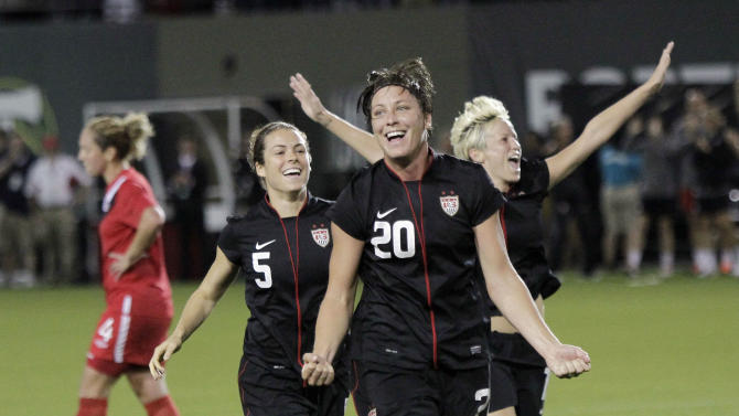U.S. Women's National Team forward Abby Wambach, middle, celebrates her goal with teammates Kelley O'Hara, left, and Megan Rapinoe during the second half of their Celebration Series soccer game against Canada in Portland, Ore.,  Thursday, Sept. 22, 2011.  Wambach scored two goals as they won 3-0.(AP Photo/Don Ryan)