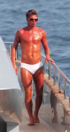 OK. Fine, David Beckham! You actually look good in a Speedo. (shaking fist in air)