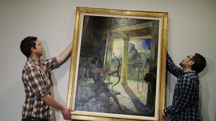 Luke Barley, left, and Hiro Sakaguchi handle the N.C. Wyeth painting titled The Trial of the Bow at the Philadelphia Museum of Art Tuesday, March 5, 2013, in Philadelphia. Pharmaceutical company GlaxoSmithKline donated the painting to the museum. (AP Photo/Matt Rourke)