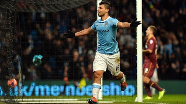 Manchester City's Argentinian striker Sergio Aguero celebrates scoring his third goal during the English FA Cup fourth round football match between Manchester City and Watford (AFP)