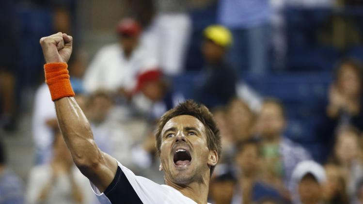 Tommy Robredo of Spain celebrates after defeating Nick Kyrgios of Australia during their men's singles match at the 2014 U.S. Open tennis tournament in New York