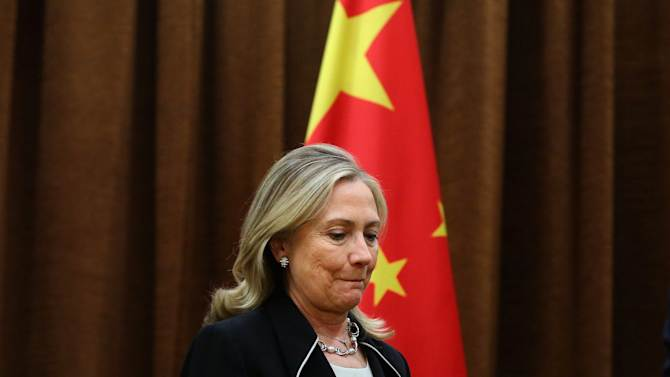 U.S. Secretary of State Hillary Rodham Clinton, left, meets Chinese Foreign Minister Yang Jiechi, not in photo, at the Ministry of Foreign Affairs in Beijing Tuesday, Sept. 4, 2012.  Clinton is in Beijing to press Chinese authorities to agree to peacefully resolve disputes with their smaller neighbors over competing territorial claims in the South China Sea. (AP Photo/Feng Li, Pool)