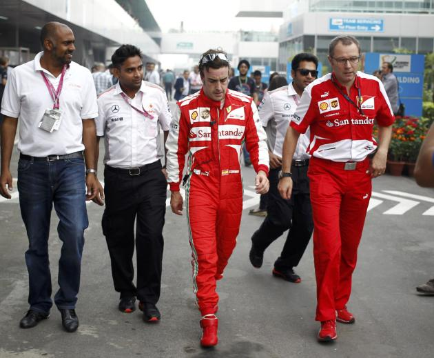 Ferrari Formula One driver Alonso walks with Team Principal Domenicali during the Indian F1 Grand Prix at the Buddh International Circuit in Greater Noida