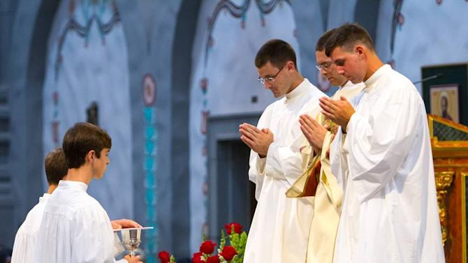Frater Matthew Desme assisting as acolyte at the ceremony for the most recent ordination of a priest of our community.  This occurred at Mission San Juan Capistrano Basilica this past June.