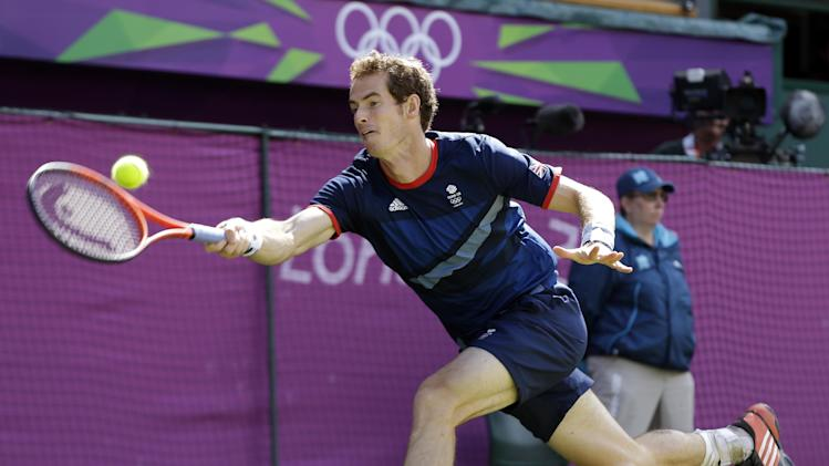 Andy Murray of Great Britain returns to Roger Federer of Switzerland during the gold medal men's singles match at the All England Lawn Tennis Club in Wimbledon, London at the 2012 Summer Olympics, Sunday, Aug. 5, 2012. (AP Photo/Elise Amendola)