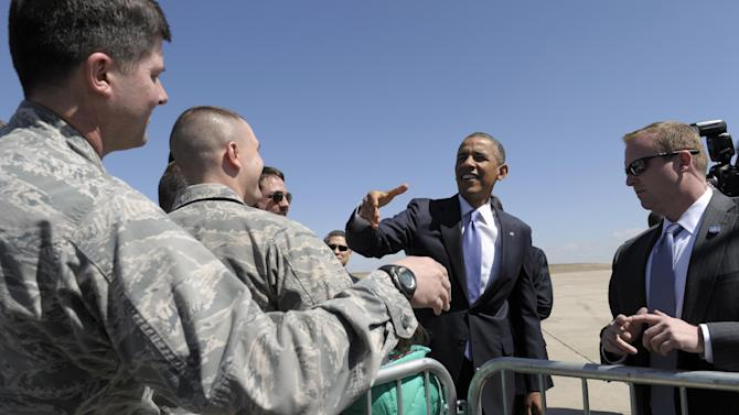 President Barack Obama greets people after arriving at Buckley Air Force Base, Colo.,Wednesday, April 3, 2013. Obama is meeting with local law enforcement officials and community leaders to discuss the state's new measures to reduce gun violence. (AP Photo/Susan Walsh)