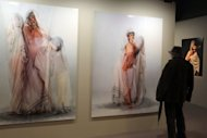 "A man looks at pictures displayed at the Arab World Institute as part of the exhibition ""Le corps à découvert"" (""The Body Uncovered"") on April 4 in Paris. Until July 15 the Institute will display 200 works by 70 modern and contemporary Arab artists, many of them women"