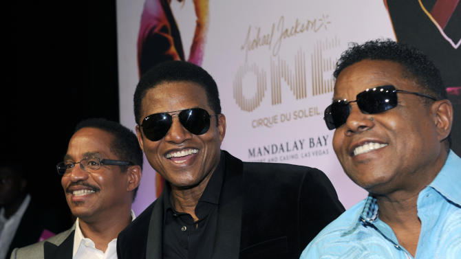 """The Jacksons, from left, Marlon Jackson, Tito Jackson and Jackie Jackson arrive at the world premiere of """"Michael Jackson ONE"""" at THEhotel at Mandalay Bay Resort and Casino on Saturday, June 29, 2013 in Las Vegas. (Photo by David Becker/Invision/AP)"""