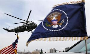 Marine One lands carrying U.S. President Barack Obama and first lady Michelle Obama at the Wall Street heliport in New York City