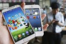 Picture illustration of Samsung Electronics' Galaxy S4 and Apple's iPhone 5 taken in Seoul