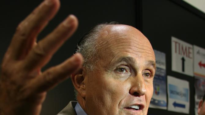 Former New York City Mayor Rudy Giuliani talks to reporters in the media filing center for the Republican Naitonal Convention on Wednesday, Aug. 29, 2012. (Torrey AndersonSchoepe/Yahoo! News)