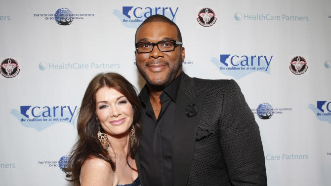 "IMAGE DISTRIBUTED FOR CARRY FOUNDATION - Lisa Vanderpump and Tyler Perry arrive at CARRY Foundation's 7th Annual ""Shall We Dance"" Gala at The Beverly Hilton Hotel on Saturday, May 11, 2013 in Beverly Hills, California. (Photo by Todd Williamson/Invision for CARRY Foundation/AP Images)"